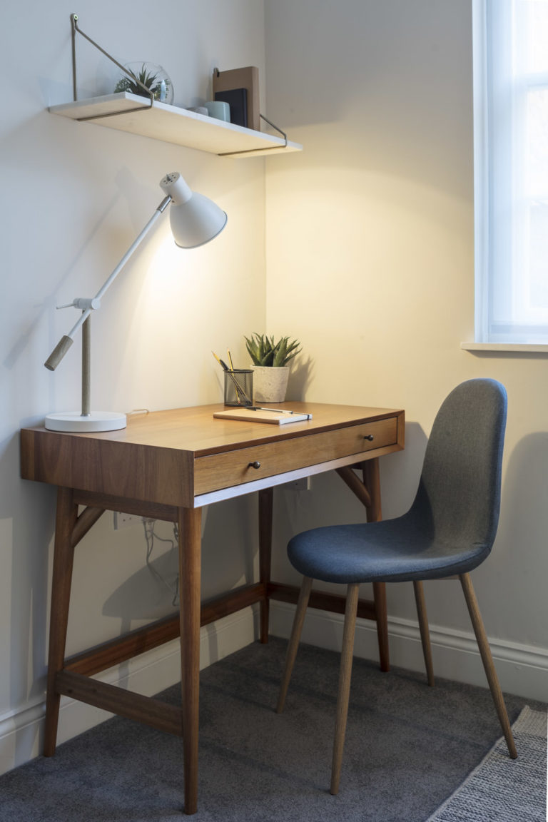 Counselling room with wooden desk