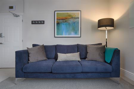 Room to rent with large sofa in Wilmslow