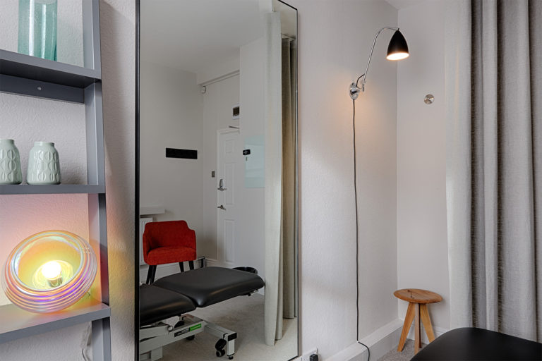Treatment room with massage bed