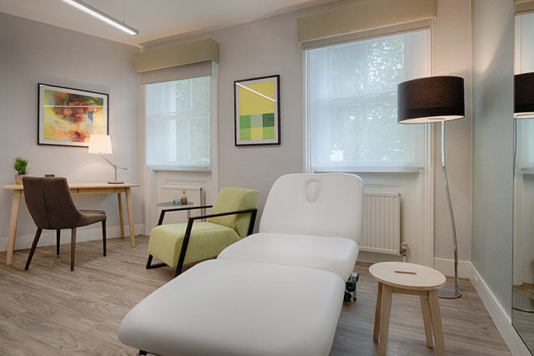 Massage bed in therapy room based in London